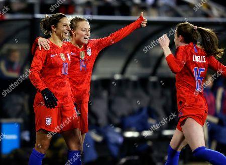 United States forward Carli Lloyd, left, defender Emily Sonnett, center, and midfielder Rose Lavelle celebrate Lloyd's second goal against Sweden during the first half of a women's international friendly soccer match in Columbus, Ohio