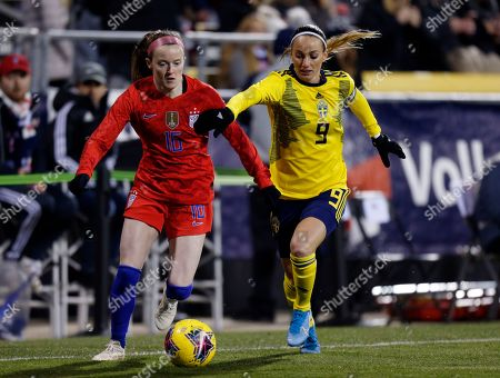 United States midfielder Rose Lavelle, left, chases the ball in front of Sweden midfielder Kosovare Asllani during the first half of a women's international friendly soccer match in Columbus, Ohio