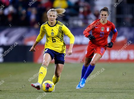Sweden defender Magdalena Eriksson, left, controls the ball against United States forward Carli Lloyd during the first half of a women's international friendly soccer match in Columbus, Ohio