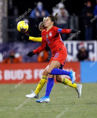 United States forward Carli Lloyd, right, heads ghe ball against Sweden midfielder Emma Kullberg during the second half of a women's international friendly soccer match in Columbus, Ohio