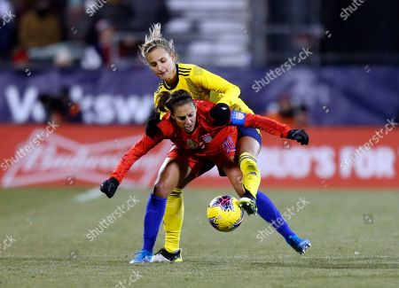 Sweden defender Nathalie Bjorn, top, tries to pass the ball against United States forward Carli Lloyd during the second half of a women's international friendly soccer match in Columbus, Ohio
