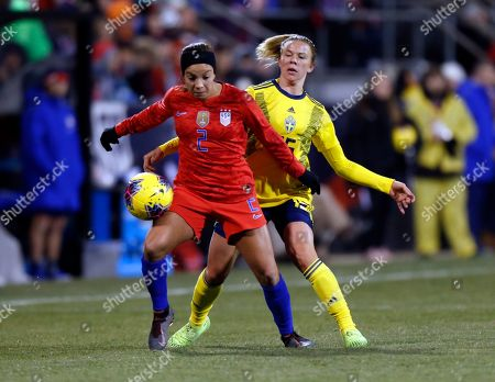 Stock Image of United States forward Mallory Pugh, left, controls the ball in front of Sweden defender Jessica Samuelsson during the second half of a women's international friendly soccer match in Columbus, Ohio