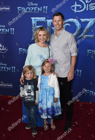 """Beverley Mitchell, Michael Cameron, Hutton Michael Cameron, Kenzie Cameron. Beverley Mitchell, left, and Michael Cameron, right pose with children Hutton Michael Cameron, bottom left, and Kenzie Cameron, bottom right at the world premiere of """"Frozen 2"""" at the Dolby Theatre, in Los Angeles"""