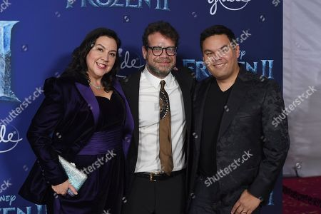 """Kristen Anderson-Lopez, Christophe Beck, Robert Lopez. Songwriters Kristen Anderson-Lopez, left, and Robert Lopez, right, pose with composer Christophe Beck, center, at the world premiere of """"Frozen 2"""" at the Dolby Theatre, in Los Angeles"""