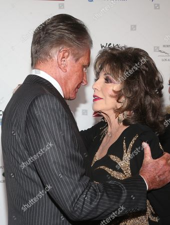 Stock Picture of George Hamilton, Joan Collins