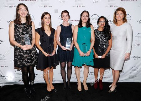 L'Oreal USA FWIS honorees, left to right, Dr. Christine Roden; Dr. Lisa Poulikakos; Dr. Laurie Bizimana; Dr. Samantha Bova; and Dr. Aparna Bhaduri with journalist and host Nora O'Donnell at L'Oreal USA's 2019 For Women in Science Awards at Carnegie Institution for Science on in Washington