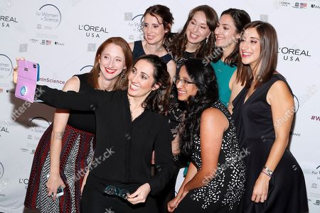 Stock Image of Professor Pardis Sabeti, center, former For Women in Science fellow, takes a selfie with the honorees at L'Oreal USA's 2019 For Women in Science Awards at Carnegie Institution for Science on in Washington