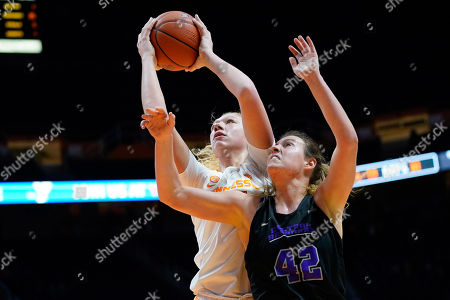 Stock Photo of Emily Saunders #31 of the Tennessee Lady Vols shoots the ball over Hannah Langhi #42 of the Central Arkansas Sugar Bears during the NCAA basketball game between the University of Tennessee Lady Volunteers and the University of Central Arkansas Sugar Bears at Thompson Boling Arena in Knoxville TN Tim Gangloff/CSM