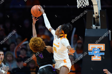Zaay Green #14 of the Tennessee Lady Vols blocks the shot attempt by Taylor Sells #4 of the Central Arkansas Sugar Bears during the NCAA basketball game between the University of Tennessee Lady Volunteers and the University of Central Arkansas Sugar Bears at Thompson Boling Arena in Knoxville TN Tim Gangloff/CSM