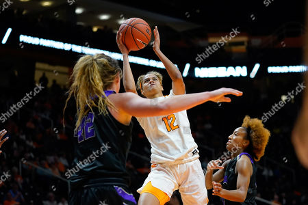 Rae Burrell #12 of the Tennessee Lady Vols tries to shoots the ball against Hannah Langhi #42 and Taylor Sells #4 of the Central Arkansas Sugar Bears during the NCAA basketball game between the University of Tennessee Lady Volunteers and the University of Central Arkansas Sugar Bears at Thompson Boling Arena in Knoxville TN Tim Gangloff/CSM