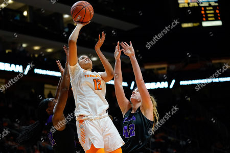 Stock Photo of Rae Burrell #12 of the Tennessee Lady Vols tries to shoots the ball against Hannah Langhi #42 and Alana Canady #22 of the Central Arkansas Sugar Bears during the NCAA basketball game between the University of Tennessee Lady Volunteers and the University of Central Arkansas Sugar Bears at Thompson Boling Arena in Knoxville TN Tim Gangloff/CSM