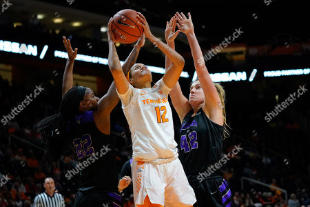 Stock Picture of Rae Burrell #12 of the Tennessee Lady Vols tries to shoots the ball against Hannah Langhi #42 and Alana Canady #22 of the Central Arkansas Sugar Bears during the NCAA basketball game between the University of Tennessee Lady Volunteers and the University of Central Arkansas Sugar Bears at Thompson Boling Arena in Knoxville TN Tim Gangloff/CSM