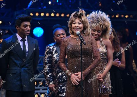"Stock Picture of Daniel J. Watts, Tina Turner, Adrienne Warren. Singer Tina Turner, center, speaks on stage with actors Daniel J. Watts, left, and Adrienne Warren on the opening night of ""Tina ñ The Tina Turner Musical"" at the Lunt-Fontanne Theatre, in New York"