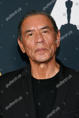 Wes Studi poses at the Academy Nicholl Fellowships in Screenwriting Awards and Live Read at the Academy of Motion Picture Arts and Sciences Samuel Goldwyn Theater on in Beverly Hills, Calif