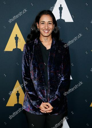 Stock Photo of Geeta Malik poses at the Academy Nicholl Fellowships in Screenwriting Awards and Live Read at the Academy of Motion Picture Arts and Sciences Samuel Goldwyn Theater on in Beverly Hills, Calif