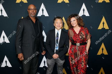 Stock Picture of Tyger Williams, Marcus Hu,Kiwi Smith. From left to right, Tyger Williams, Marcus Hu and Kiwi Smith pose at the Academy Nicholl Fellowships in Screenwriting Awards and Live Read at the Academy of Motion Picture Arts and Sciences Samuel Goldwyn Theater on in Beverly Hills, Calif