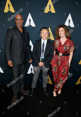 Tyger Williams, Marcus Hu,Kiwi Smith. From left to right, Tyger Williams, Marcus Hu and Kiwi Smith pose at the Academy Nicholl Fellowships in Screenwriting Awards and Live Read at the Academy of Motion Picture Arts and Sciences Samuel Goldwyn Theater on in Beverly Hills, Calif
