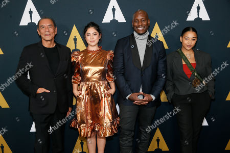 Stock Image of Wes Studi, Rosa Salazar, Tyrese Gibson, Amandla Stenberg. Actors, from left to right, Wes Studi, Rosa Salazar, Tyrese Gibson and Amandla Stenberg pose at the Academy Nicholl Fellowships in Screenwriting Awards and Live Read at the Academy of Motion Picture Arts and Sciences Samuel Goldwyn Theater on in Beverly Hills, Calif