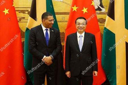 Jamaican Prime Minister Andrew Holness (L) attends a signing ceremony with Chinese Premier Li Keqiang (R) at the Great Hall of the People in Beijing, China, 08 November 2019.