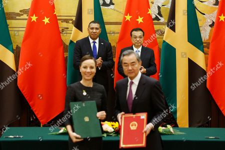 Jamaican Prime Minister Andrew Holness (L, second row) and Chinese Premier Li Keqiang (R, second row) attend a signing ceremony with Jamaican Foreign Minister Kamina Johnson-Smith (L, first row) and Chinese Foreign Minister Wang Yi (R, first row), at the Great Hall of the People in Beijing, China, 08 November 2019.