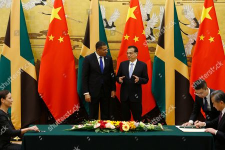 Jamaican Prime Minister Andrew Holness (C-L) and Chinese Premier Li Keqiang (C-R) attend a signing ceremony with Jamaican Foreign Minister Kamina Johnson-Smith (L) and Chinese Foreign Minister Wang Yi (R), at the Great Hall of the People in Beijing, China, 08 November 2019.