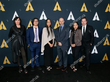 Jennifer Yuh Nelson, Academy Short Films and Feature Animation Branch Governor and Nicholl Fellowships in Screenwriting Committee Chair, third from left, poses with Nicholl fellows, from left to right, Karen McDermott, Aaron Chung, Walker McKnight, Renee Pillai and Sean Malcolm at the Academy Nicholl Fellowships in Screenwriting Awards and Live Read at the Academy of Motion Picture Arts and Sciences Samuel Goldwyn Theater, in Beverly Hills, Calif