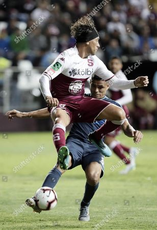 Christian Bolanos (L) of Deportivo Saprissa in action against Juan Pablo Montes (R) of Motagua during the first leg CONCACAF League final soccer match between Deportivo Saprissa and Motagua at the Ricardo Saprissa Ayma Stadium in San Jose, Costa Rica, 07 November 2019.