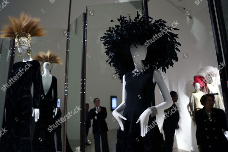 Stock Picture of Visitors inspect items displayed for the exhibition 'Naty Abascal and fashion!', at the Jumex Museum in Mexico City, Mexico, 07 November 2019. The show brings together designers such as Oscar de la Renta, Valentino and Yves Saint Laurent, whose creations have been worn by the Spanish model Nati Abascal.