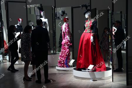 Visitors inspect items displayed for the exhibition 'Naty Abascal and fashion!', at the Jumex Museum in Mexico City, Mexico, 07 November 2019. The show brings together designers such as Oscar de la Renta, Valentino and Yves Saint Laurent, whose creations have been worn by the Spanish model Nati Abascal.