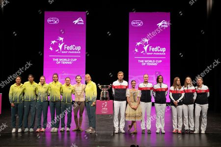 Stock Photo of Team Australia (L) and Team France (R) pose for a photograph with WA Ballet dancers Jesse Homes (6-L) and Claire Voss (6-R) during the official draw of 2019 Fed Cup at the Heath Ledger Theatre in Perth, Western Australia, Australia, 08 November 2019. Australia's final against France will be held in Perth on 09 and 10 November.