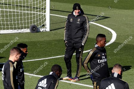 Real Madrid's head coach Zinedine Zidane (C), supervises his players during a training session at Valdebebas sports city in Madrid, Spain, 08 November 2019. Real Madrid will face SD Eibar in a Spanish LaLiga soccer match on 09 November.