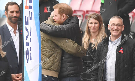 Britain's Prince Harry, The Duke of Sussex (R) greets with former Wales rugby captain Gareth Thomas (L) at the Stoop, Twickenham,  London, Britain, 08 November 2019. The Duke of Sussex has attended a Terrence Higgins Trust event ahead of a National HIV testing week campaign.