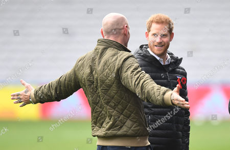 Britain's Prince Harry, The Duke of Sussex (R) shares a joke with former Wales rugby captain Gareth Thomas (L) at the Stoop, Twickenham,  London, Britain, 08 November 2019. The Duke of Sussex has attended a Terrence Higgins Trust event ahead of a National HIV testing week campaign.