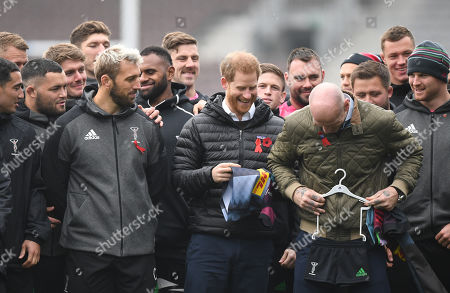 Britain's Prince Harry, The Duke of Sussex (C) former Wales rugby captain Gareth Thomas (L) and Harlequins Captain Chris Robshaw (L) pose for photos at the Stoop, Twickenham,  London, Britain, 08 November 2019. The Duke of Sussex has attended a Terrence Higgins Trust event ahead of a National HIV testing week campaign.