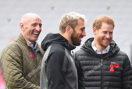 Stock Photo of Britain's Prince Harry, The Duke of Sussex (R) former Wales rugby captain Gareth Thomas (L) and Harlequins Captain Chris Robshaw (C) share a joke at the Stoop, Twickenham,  London, Britain, 08 November 2019. The Duke of Sussex has attended a Terrence Higgins Trust event ahead of a National HIV testing week campaign.