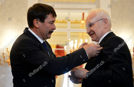 Hungarian President Janos Ader (L) awards former Minister President of the state of Bavaria  and former chairman of the Christian Social Union (CSU) Edmund Stoiber (R) with the Grand Cross of the Hungarian Order of Merit in the presidential Alexander Palace in Budapest, Hungary, 08 November 2019.