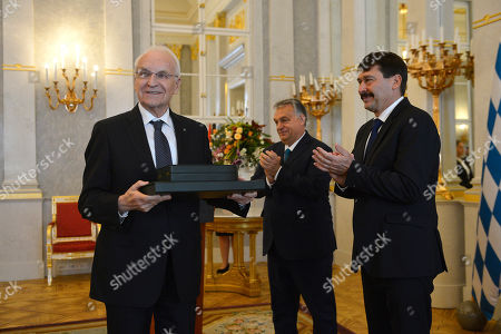 Former Minister President of the state of Bavaria and former chairman of the Christian Social Union (CSU) Edmund Stoiber (L) reacts after being awarded with the Grand Cross of the Hungarian Order of Merit by Hungarian President Janos Ader (R) and Hungarian Prime Minister Viktor Orban (C) in the presidential Alexander Palace in Budapest, Hungary, 08 November 2019.