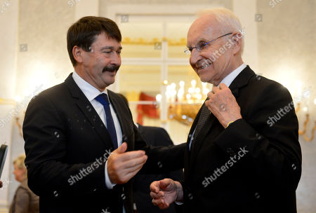Stock Picture of Hungarian President Janos Ader (L) awards former Minister President of the state of Bavaria  and former chairman of the Christian Social Union (CSU) Edmund Stoiber (R) with the Grand Cross of the Hungarian Order of Merit in the presidential Alexander Palace in Budapest, Hungary, 08 November 2019.