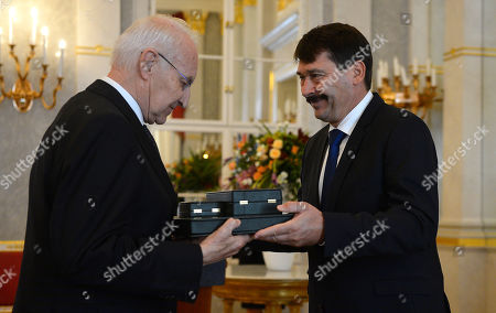 Stock Photo of Hungarian President Janos Ader (R) awards former Minister President of the state of Bavaria  and former chairman of the Christian Social Union (CSU) Edmund Stoiber (L) with the Grand Cross of the Hungarian Order of Merit in the presidential Alexander Palace in Budapest, Hungary, 08 November 2019.