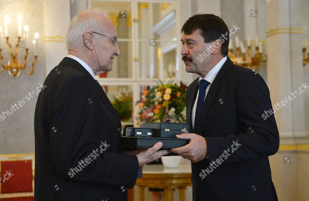 Hungarian President Janos Ader (R) awards former Minister President of the state of Bavaria  and former chairman of the Christian Social Union (CSU) Edmund Stoiber (L) with the Grand Cross of the Hungarian Order of Merit in the presidential Alexander Palace in Budapest, Hungary, 08 November 2019.