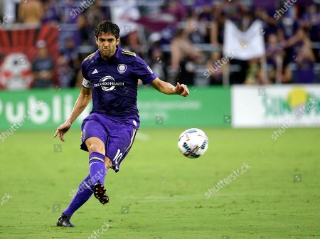 Orlando City's Kaka takes a free kick against Atlanta United in Orlando, Fla. The international soccer players now studying on an executive masters course could field one of the best school teams ever seen. After classes this week, Ballon d'Or winner Kaka was joined on the field by Champions League winners Florent Malouda and Julio Cesar and an array of one-time national team stars. Didier Drogba, though not playing, and Andriy Arshavin are also classmates for an 18-month education now in its third edition