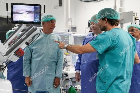 Prince Aga Khan IV (C) together with Portugal's President Marcelo Rebelo de Sousa (L) receive explanations during the inauguration of the donated robotic surgery equipment by the Ismaili Imamat comunity to the Curry Cabral national hospital in Lisbon, Portugal, 08 November 2019.