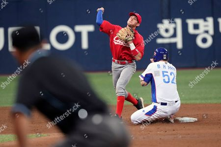 Stock Picture of Park Byung-ho. Erisbel Arruebarruena. South Korea's Park Byung-ho is out at second as Cuba shortstop Erisbel Arruebarruena turns a double play during the third inning at an Olympic qualifying tournament at Gocheok Sky Dome in Seoul, South Korea, . South Korea defeated Cuba 7-0