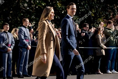 Lara Trump, Jared Kushner. Lara Trump, the wife of Eric Trump, left, and President Donald Trump's White House senior adviser Jared Kushner, right, walk to across the South Lawn to join President Donald Trump on Marine One on the South Lawn of the White House in Washington, for a short trip to Andrews Air Force Base, Md. and then on to Georgia to meet with supporters