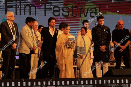 Stock Picture of Bollywood actor Rakhee Gulzar, center, unveils the festival souvenir, flanked by Chief Minister of West Bengal state Mamata Banerjee, third right, and Shah Rukh Khan, third left, during the inauguration of the 25th Kolkata International Film Festival in Kolkata, India, . The festival will continue till Nov. 15