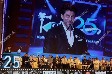 Bollywood actor Shah Rukh Khan delivers his speech during the inauguration of the 25th Kolkata International Film Festival in Kolkata, India, . The festival will continue till Nov. 15