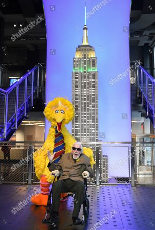Big Bird, Caroll Spinney. Sesame Street's Big Bird and puppeteer Caroll Spinney participate in the ceremonial lighting of the Empire State Building in honor of Sesame Street's 50th anniversary, in New York