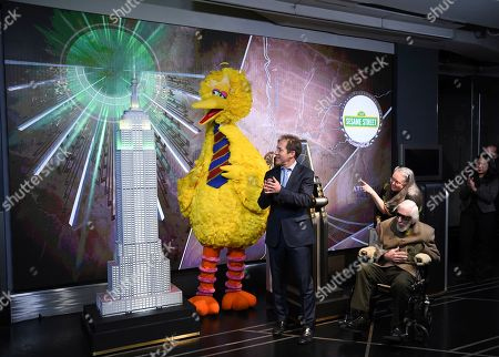 Steve Youngwood, Debra Spinney, Caroll Spiney. Sesame Street's Big Bird, Sesame Workshop president of media & education and CEO Steve Youngwood with Debra Spinney and puppeteer Caroll Spinney, seated right, participate in the ceremonial lighting of the Empire State Building in honor of Sesame Street's 50th anniversary, in New York