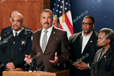 Stock Photo of Former Los Angeles police Chief Charlie Beck speaks after being named Chicago's interim police superintendent by Chicago Mayor Lori Lightfoot, right, on in Chicago. The announcement comes a day after Superintendent Eddie Johnson, second from left, announced his retirement after more than three years as the city's police chief and more than 30 years with the department