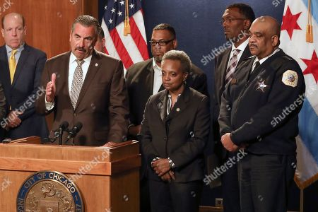 Stock Image of Former Los Angeles police Chief Charlie Beck speaks after being named Chicago's interim police superintendent by Chicago Mayor Lori Lightfoot, second right, on in Chicago. The announcement comes a day after Superintendent Eddie Johnson, right, announced his retirement after more than three years as the city's police chief and more than 30 years with the department